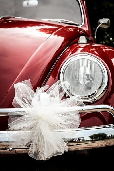 Beautiful red beetle decorated with white ribbons.