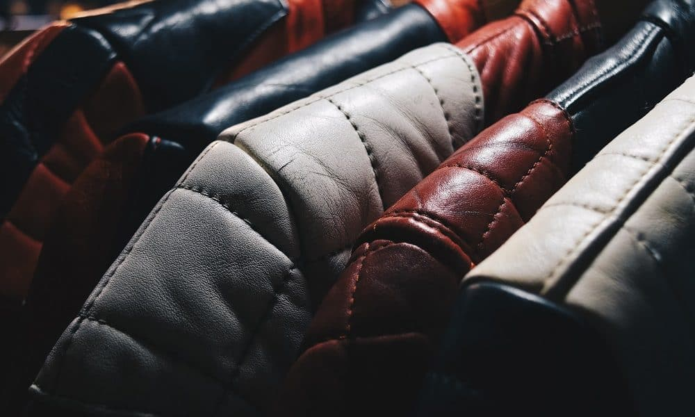Close up of leather jackets hung up.