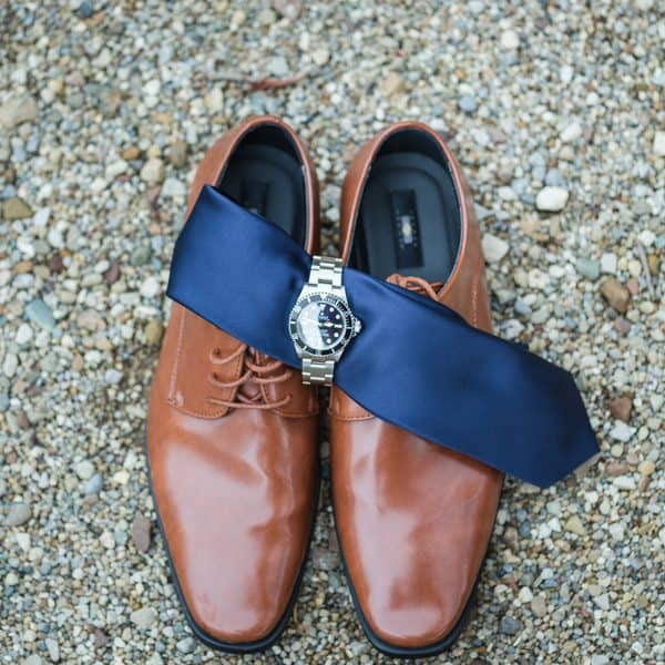 Grooms shoes, tie, and watch.