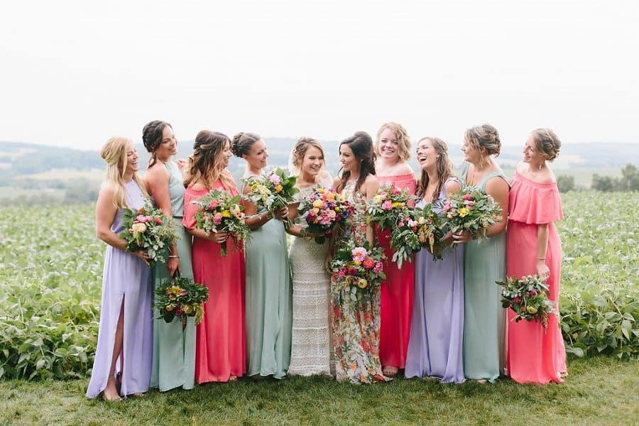 Pastel colored bridesmaids laughing