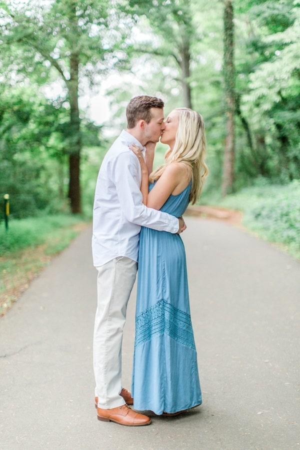 engaged couple kissing shot